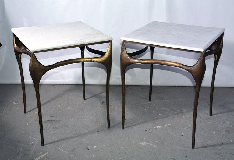 Gold toned freeform modernist side, end table or coffee table has a white marble top.