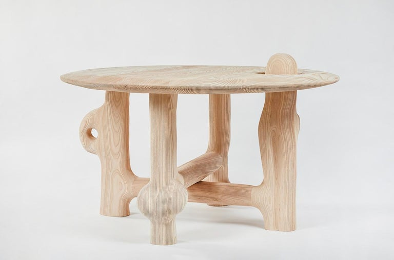 Organic hand carved sculptural dining table in Sandblasted ash. Made in the USA by Casey McCafferty. 