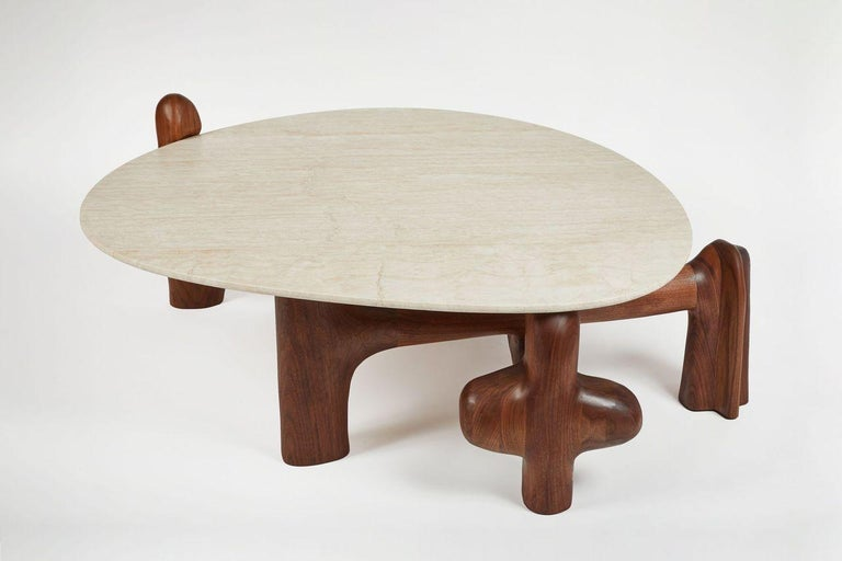 Organic hand carved sculptural low/coffee table in Oiled Walnut. Made in the USA by Casey McCafferty.   Stone top is provided but every piece is different. Other options for stone are available but may incur extra charge.  Byzantium sculptural