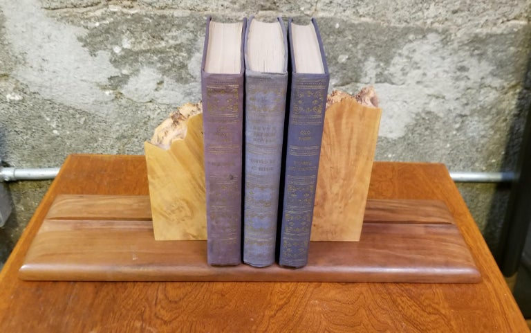 Michael Elkan's live edge bird's-eye maple and solid walnut organic bookends. Sliding, adjustable feature to accommodate number of books supported. Signed on base.