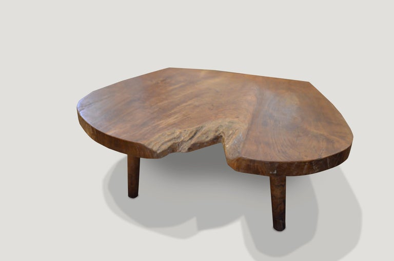 Reclaimed teak wood coffee table or side table with a natural oil finish. Floating on mid century style legs.  Andrianna Shamaris. The Leader In Modern Organic Design.