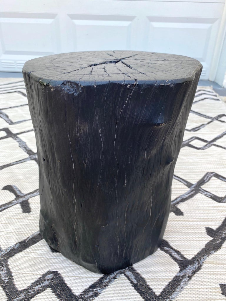 Indonesian burnt and blackened teak wood stump with organic modern design. Makes a gorgeous accent piece for a bathroom or can be used as a drink table or side table. Excellent condition with minor natural variations of lighter wood tones