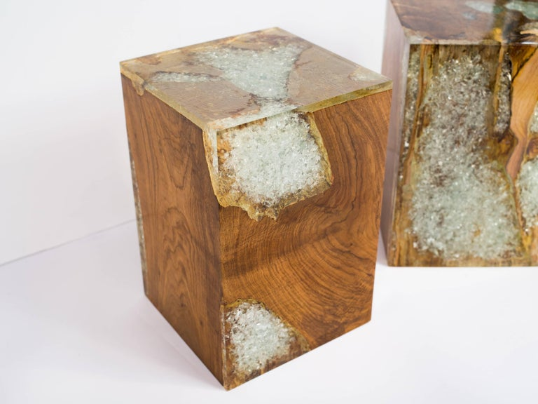 Organic modern cube table in natural and bleached teak root wood with cracked resin design. Polished finish with unique wood variations on all sides. Handcrafted and multi purpose use. Expect variation in color. Priced individually and multiple