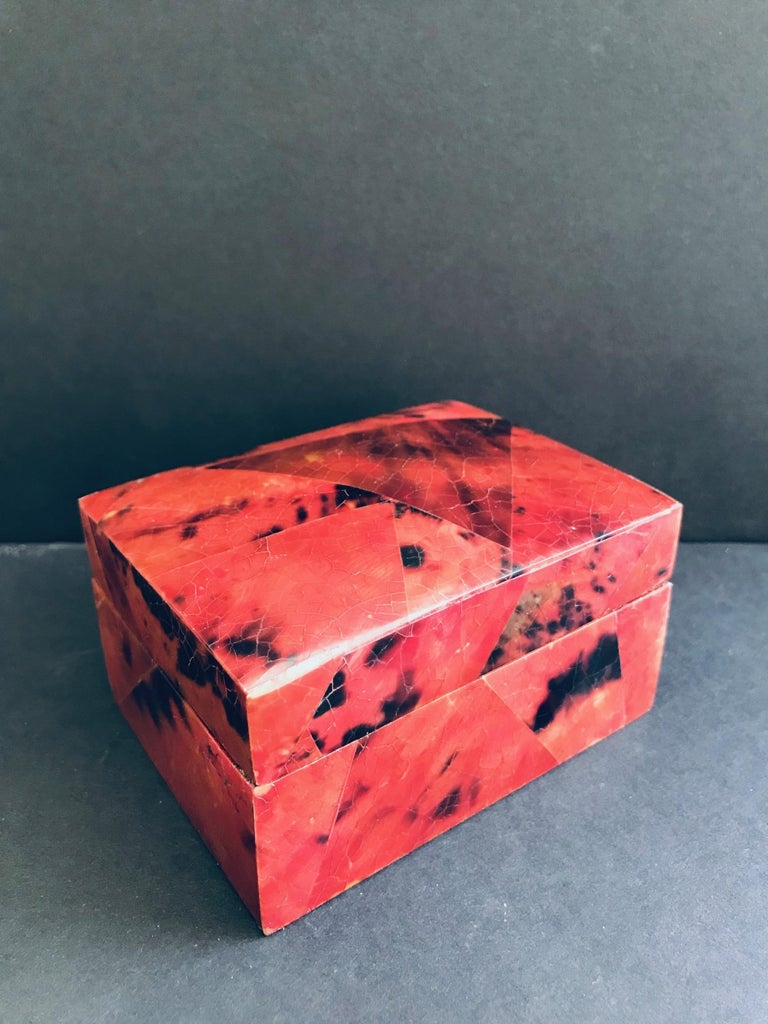 Gorgeous decorative box or jewelry box in tessellated pen-shell. Lacquered and hand-dyed in red and black with mosaic inlays throughout. Lidded Box features palmwood interior and has R&Y Augousti signature on the underside. Other matching