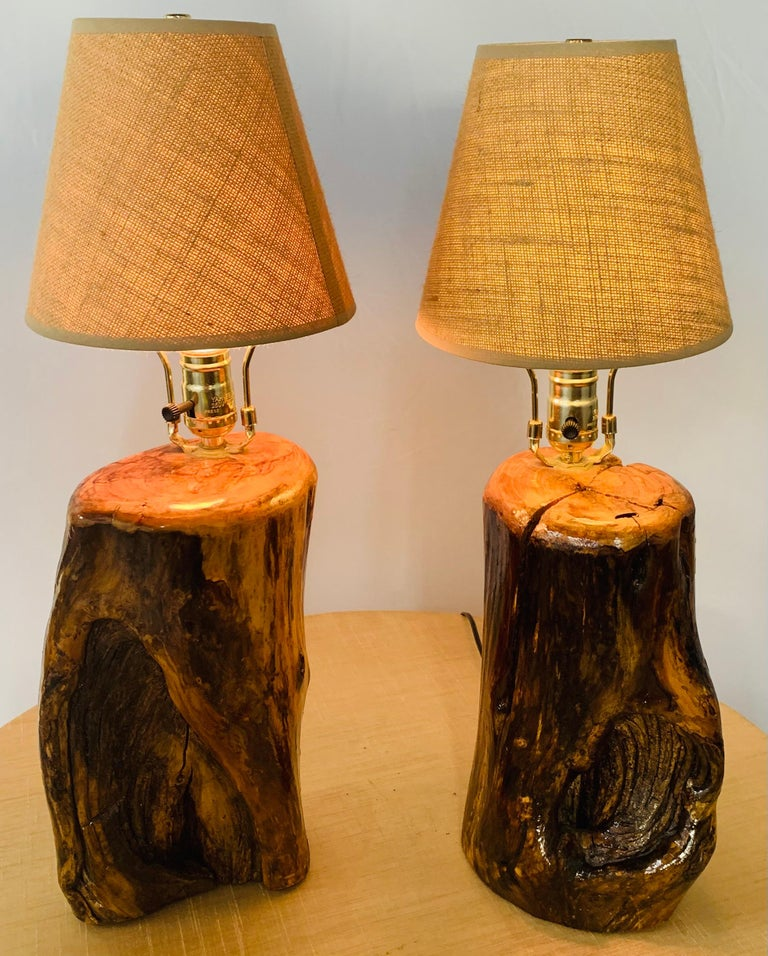 An exquisite handmade pair of organic modern design table lamps. Hand carved of high quality maple wood logs, the table lamps features original natural burl with a shiny lacquer finish. the rustic table lamps are highly decorative and would add