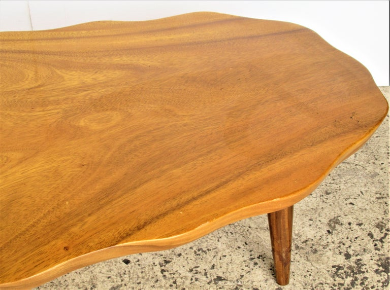 1960's organic modern monkey pod wood coffee table with biomorphic form and original glowing surface to the beautifully grained wood. Stamped on underside - made in Honolulu, Hawaii by Harry's Cabinet & Curio Shop.