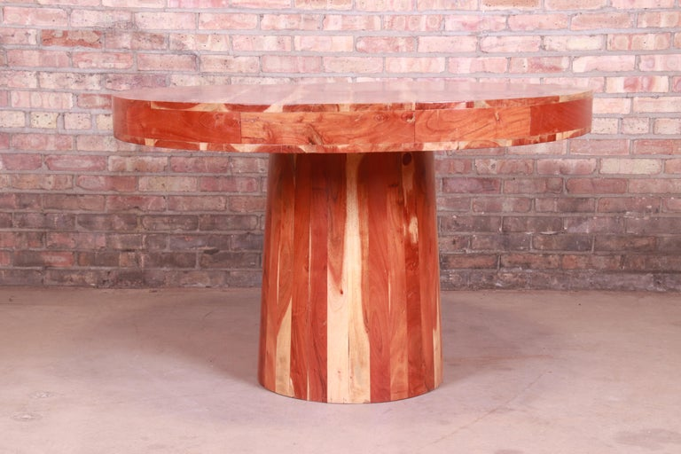 An exceptional organic modern natural solid redwood round pedestal dining table, center table, or game table,  circa 1970s  Measures: 48