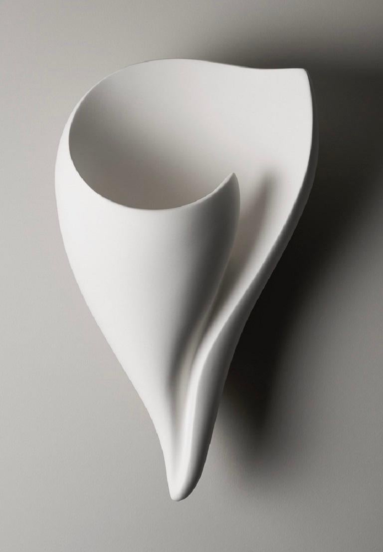 Handmade Shell organic modern sculptural wall sconce/ wall light in silky smooth white plaster, created by artist Hannah Woodhouse in her London studio. Contemporary design inspired by nature and mid-century European sculpture.  This wall sconce not