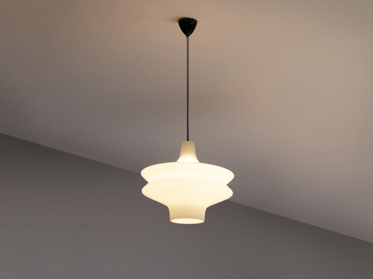 Pendant, opaline glass, metal, Europe, 1960s   Wonderful organic pendant lamp. The vivid form of the pendant lamp catches the eye. The shade beautifully floats from the top while getting wider and slimmer again. A very elegant design with