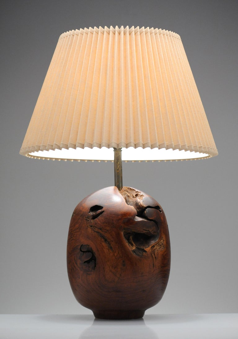 Beautiful turned wood lamp by Chris Eggers. Lamp is signed and dated 1986.   Artist statement: I primarily use tree stumps for my illuminated sculptures. Stumps are the heart of the tree, twisting in several directions with holes and knots. The
