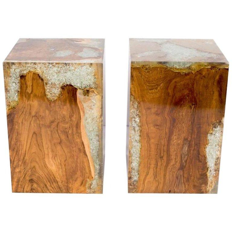 Organic modern cube tables in natural and bleached teak root wood with cracked resin design. Polished finish with unique wood variations on all sides. Handcrafted and multipurpose use. Expect variation in color. Multiple pieces are available and
