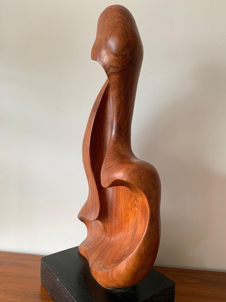 An unusual, sinuous teak wood sculpture, signed Appu. Indian artist, circa 1960s. While abstract the form is clearly derived from female figure.