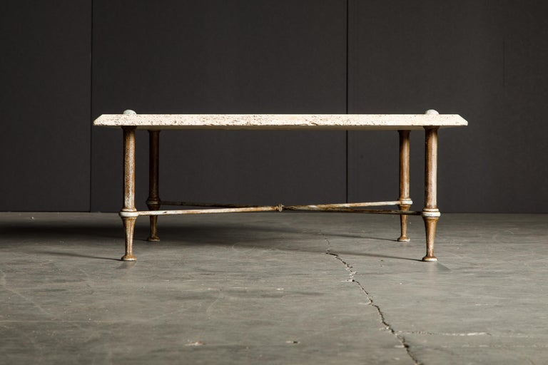 This incredibly stylish organic travertine and iron coffee table is by Stone International S.p.A. in the 1970s and this table is signed with the original label underneath the travertine top. The travertine is unfilled (organic) which gives it a