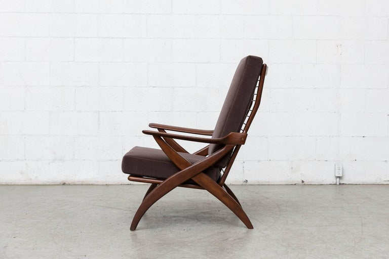 Lightly refinished midcentury high back teak lounge chair for Topform with organically carved X frame. New cafe grey velvet upholstery. Measure: Arm height 22.5