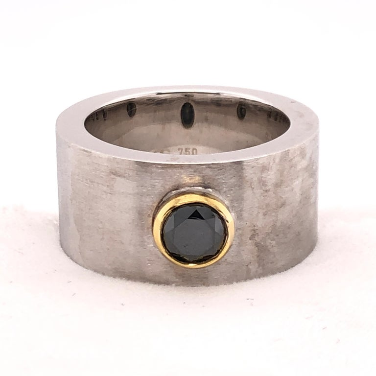 This is a substantial ring from Orianne Collins for a substantial character. A 1.02 CT round cut black diamond set into a yellow gold bezel creates the focal point against the stout brushed white gold band.  Versatile and a conversation starter,