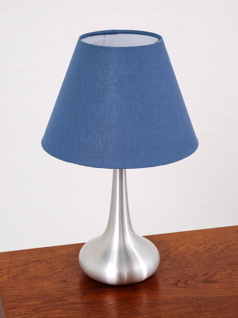 'Orient' table lamp was designed by Jo Hammerborg during the 1960s and manufactured by Fog & Mørup in Denmark. This is the 'Mini' version. The lamp body is made from aluminium. Comes with a new shade. It remains in a good vintage condition with a
