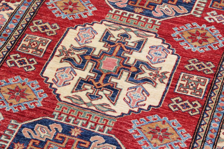 These new traditional handmade rugs are featuring designs from the Kazak region. A traditional tribal rug is famous in the region of the Kazak Area. This handwoven rug has been made by Afghan weavers of top quality wool and cotton. This carpet rug