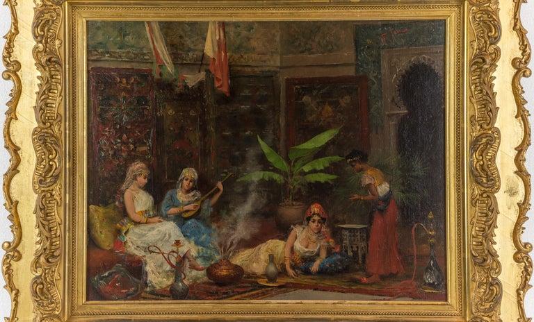 An exquisite orientalist painting depicting concubines in the harem by Fabio Fabbi  Artist: Fabio Fabbi (1861-1910) Origin: Italian Signature: signed F. Fabbi (upper right) Medium: oil on canvas Dimension: 14 in. x 18 in. (image); 21 3/4 x 25
