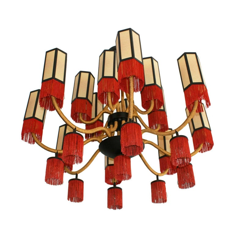 Orientalist style suspension lamp. Structure made of metal and reddish brass, coated with golden cotton cord. Fourteen octagonal shape screens made of parchment finished in cotton fringes, France 70 years.