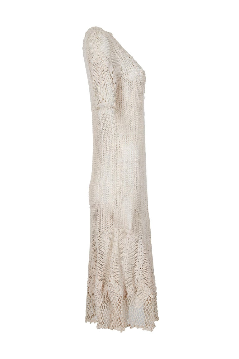 This exquisite, original 1930s hand crochet dress in ivory cream is likely of US origin and made in the Irish tradition.  It is therefore unlabelled.  It would make an enchanting choice for vintage bridal wear. The dress is ankle length with a