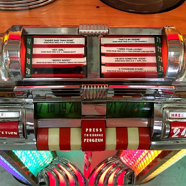 Nicknamed 'The Bullet' and following hot on the heels of the iconic 1015 came the Wurlitzer 1100, which is often said to be one of the prettiest jukeboxes ever made. Its nickname derives from the overall shape, which rises to a subtle point in the