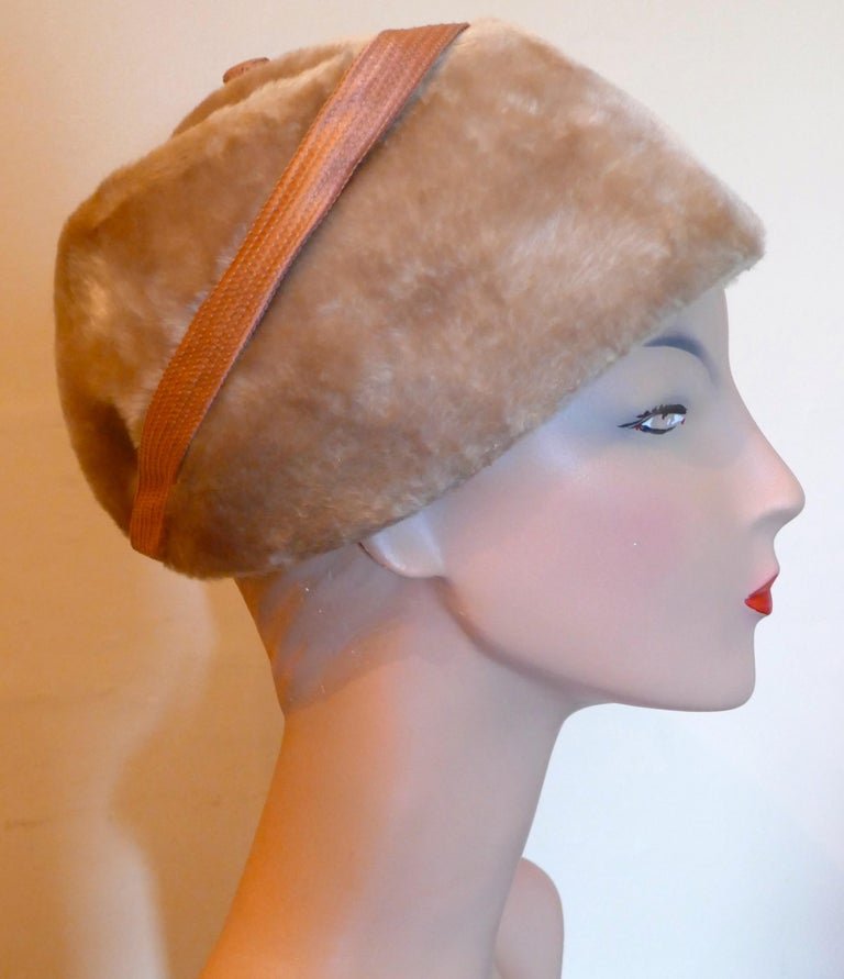 Original 1950s Felt Fur Pill Box Hat, trimmed with Satin Ribbon   This gorgeous Hat is very light and has an attractive shape, it is made in wool felt and has beautiful soft furry feel This one is an exquisite design wear it anywhere  The hat is in
