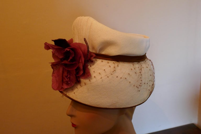 Original 1950s Pill Box Hat by Condo Model  Great Fun Cottage Loaf shaped hat, stiff straw, trimmed with a satin Bow at the back large Silk flower at the front and a veil This is a unique piece, satin lined and measures 56cm around the band  The