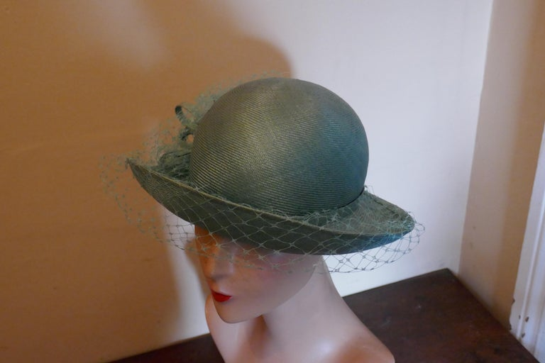 Original 1960s Duck Egg Green Veiled Shiny Panama Hat by Edna Wallace  This is a very elegant hat, it is made in soft shiny straw fabric with curled brim which is trimmed with a bow and crisp veil  This one is a classic design, a timeless pice wear