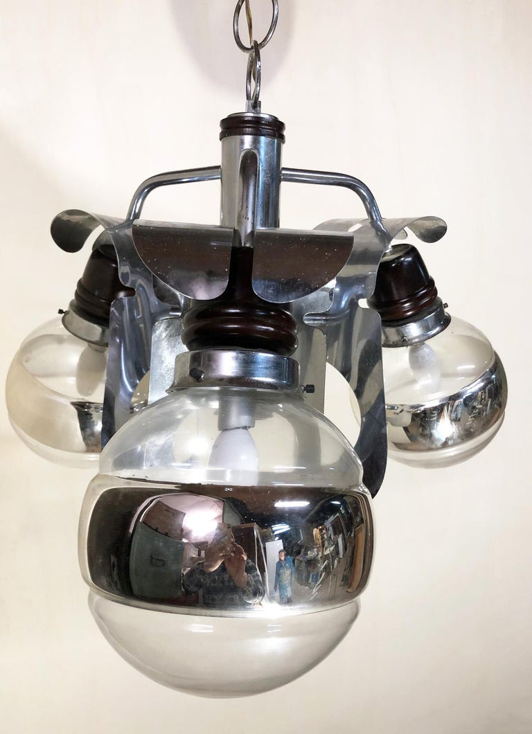 Original 1960 Italian chrome chandelier with three-light Very elegant and with a particular design In working condition. Equipped with original 20th century European wiring. We recommend buyer consults an experienced electrician for proper