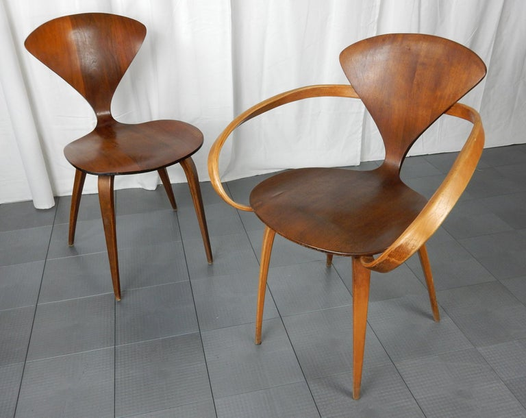 """Fabulous pair of molded plywood accent chairs designed by Norman Cherner for Plycraft. These are not reproductions rather original 1960s survivors. Original Plycraft label on underside of side chair naming """"Bernardo"""