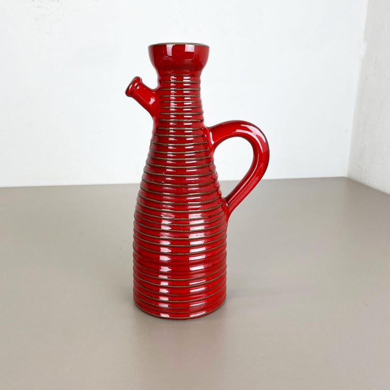 Article:  Ceramic fat lava    Producer:  Marei Ceramics, Germany   Decade:  1970s    Original vintage Studio Pottery vase was produced in the 1970s by Marei Ceramics, Germany. The vase is made of pottery with a very nice red glaze
