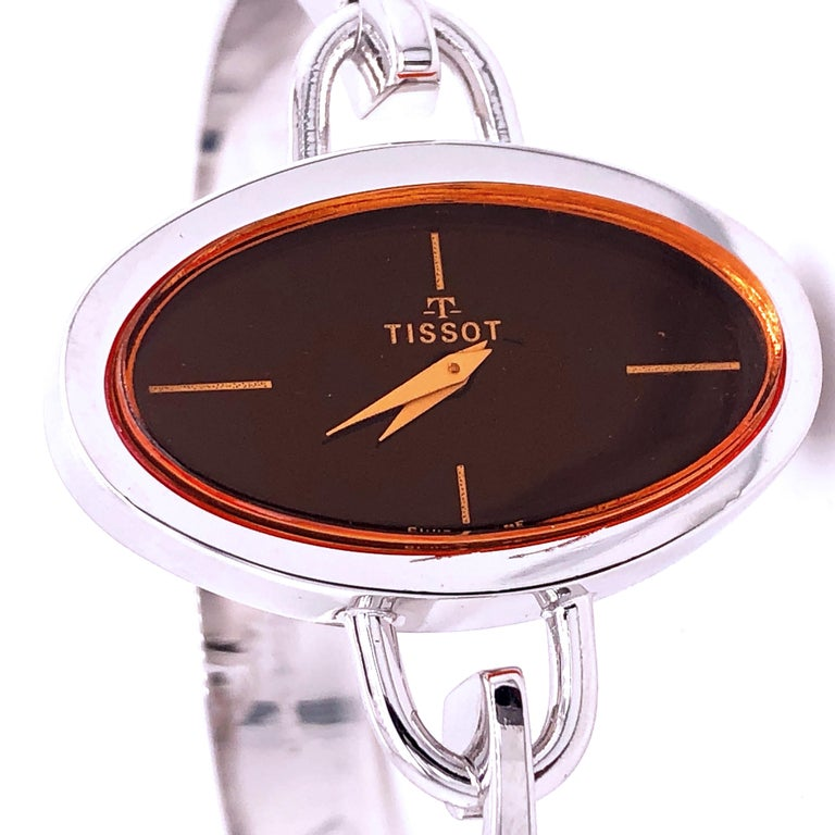 Original 1973, Exquisite Tissot Wrist Watch, an iconic piece characterized by an elegant, unique, absolutely chic, yet timeless design. There's a strong parallel between the evolution of fashion and the watches that Tissot has been creating for