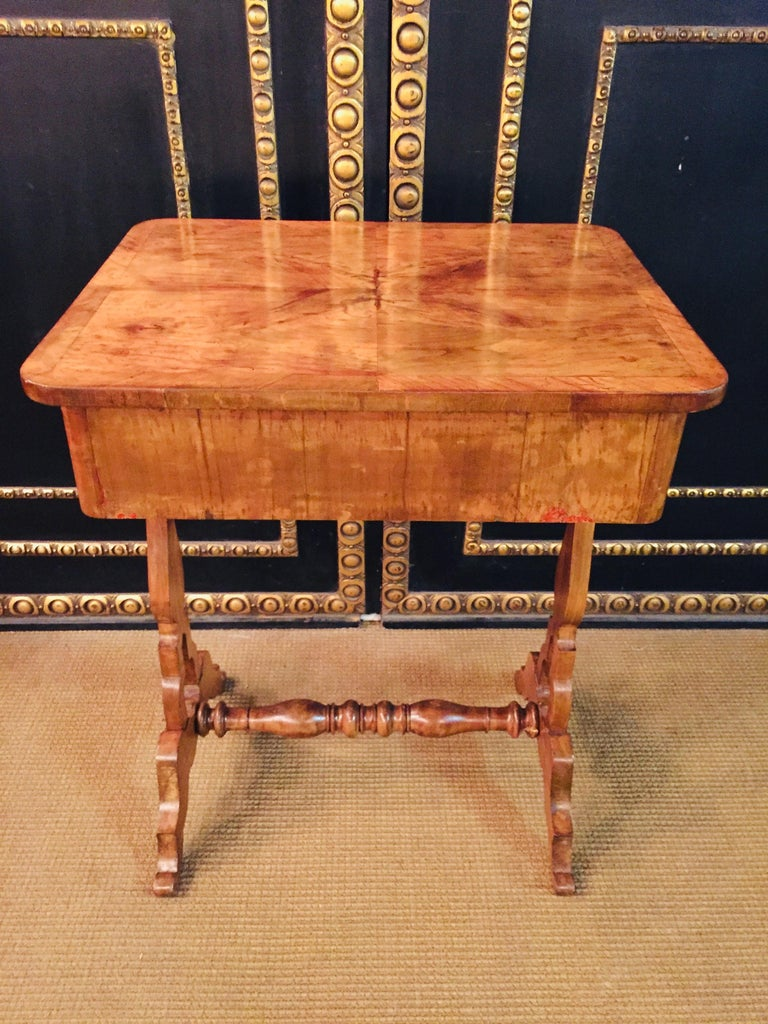 Biedermeier work and sewing table Cherry veneered 2 drawers. A pair of lyre feet on curly braces.  Plate have old wormholes but its not active.