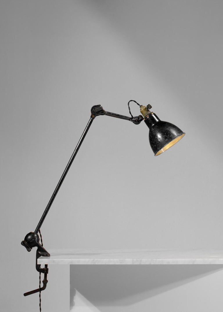 French workshop lamp created by Albert Albin Gras in the 1950s. Metal structure, lampshade and articulated arms. The