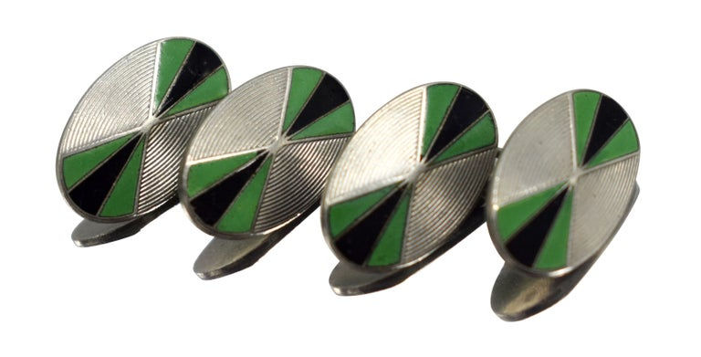 For gentleman out there who lean towards something a little different and less generic and oozing style consider these original matching pair of Art Deco men's Oval shaped cufflinks with green and black enamel decoration on an engine turned chrome