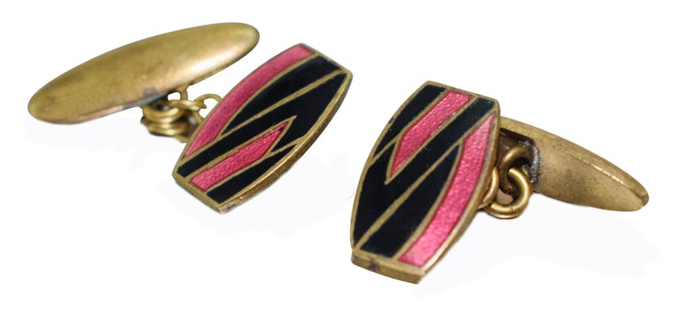 For the gentlemen out there who lean towards something a little different, less generic and oozing style consider these original matching pair of Art Deco gents cufflinks with a great geometric pattern. Gold toned metal with pink and black enamel
