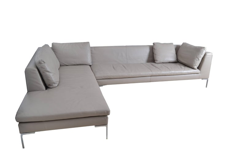 Original B&B Italia leather sectional sofa from the Maxalto collection. Model: Lucrezia, grey. This sofa consists of two sections. One straight and one chaise. Sits on die-cast aluminum Frame. Dimension smaller section: Depth 37.5 inches, length