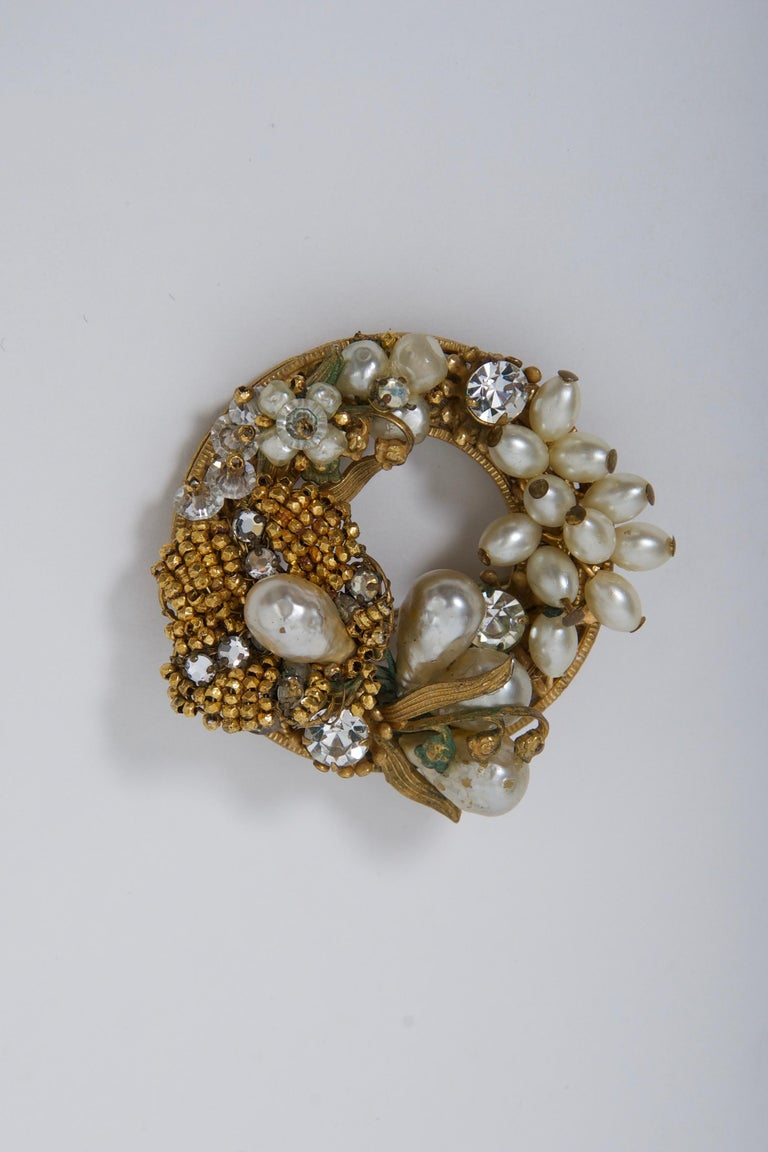 Wreath-shaped brooch of various pearls, rhinestones, crystals, and micro gold beads by Robert, c.1960. Hook in addition to pin, so can be worn as pendant. Some of the Original by Robert pieces were similar to that of Miriam Haskell and De Mario, as