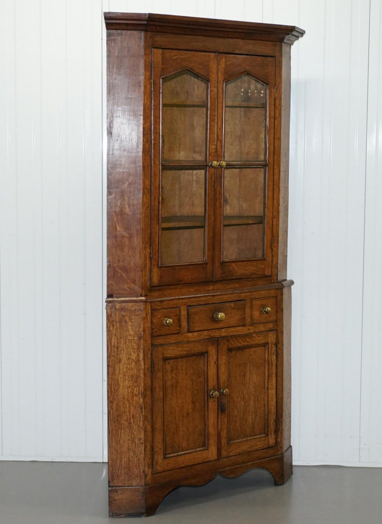 We are delighted to offer for sale this lovely original Victorian circa 1840 solid Honey Oak corner cupboard 