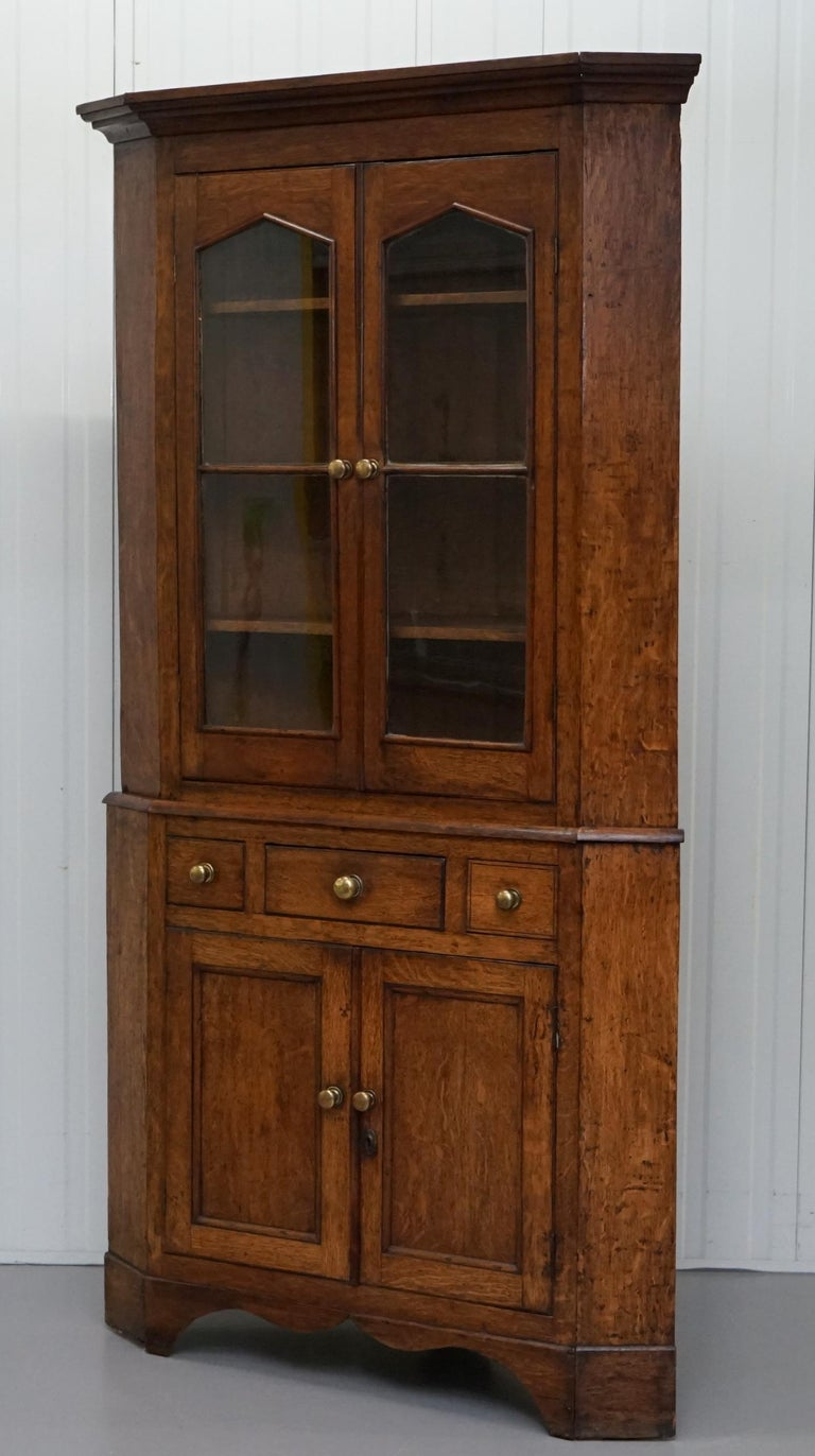 English Original circa 1840 Victorian Honey Oak Corner Cupboard Bookcase Brass Handles For Sale