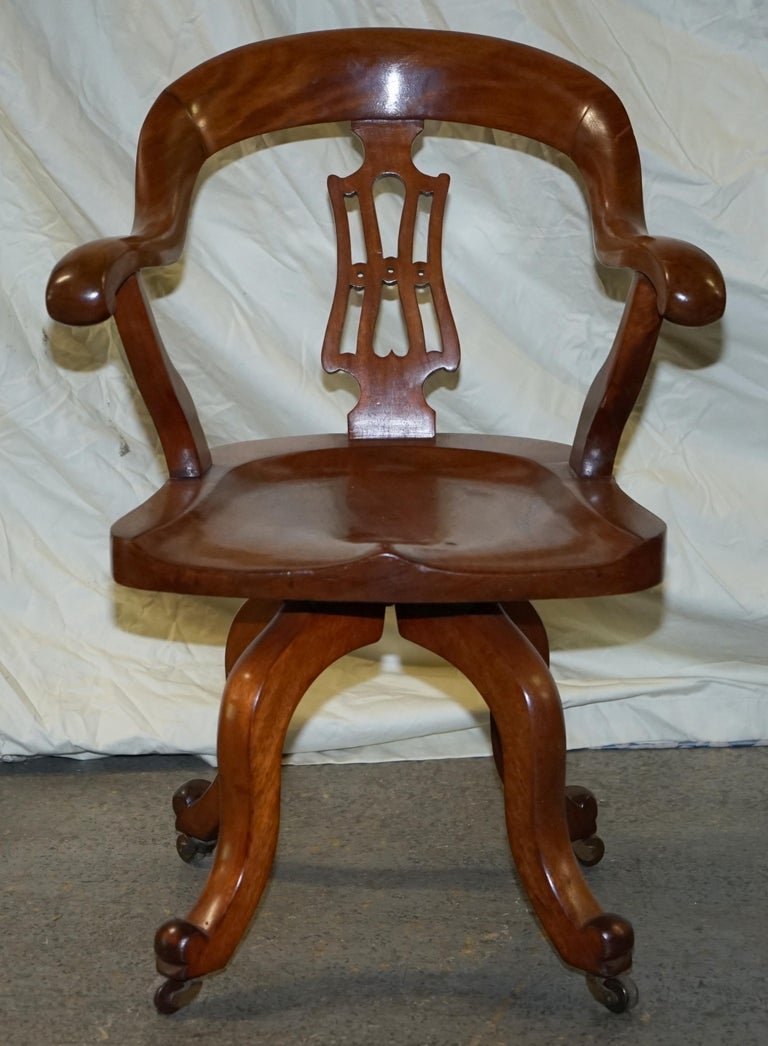 We are delighted to offer for sale this stunning original circa 1860 solid walnut Victorian captains chair with sculptural frame  A very original and good looking piece, the arms are highly sculpted and are very comfortable for a solid wood chair.