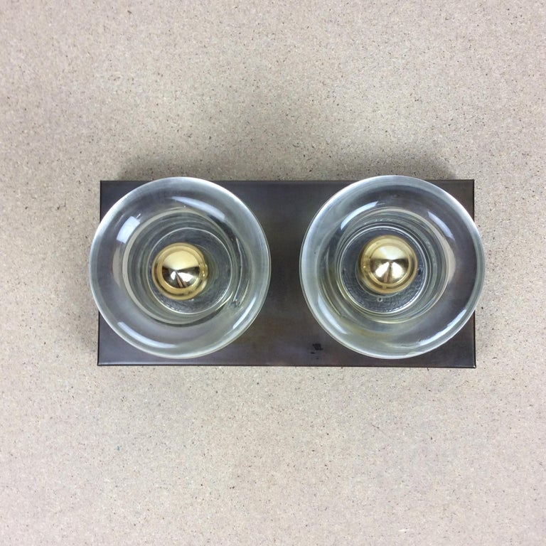 Article:  Wall ceiling light   Producer:  Cosack lights, Germany (see label)   Origin:  Germany   Age:  1970s      Original 1970s modernist wall Light with two glass lighting elements. This light was designed and produced by
