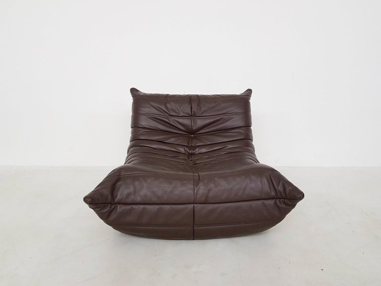 The famous lounge chair by Michel Ducaroy for Ligne Roset. Ducaroy designed the Togo as a chair without a frame. The inside of the chair only consists of foam. Very comfortable!  This Togo is a fully original piece. This means it has its original