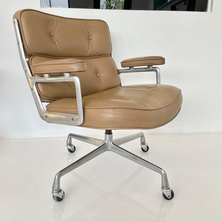 Classic Eames time life swivel chair in camel leather for Herman Miller. Unusual color. Chair swivels. Metal and leather are in good vintage condition with wear as shown. Offered with original casters. The perfect vintage office chair. Original