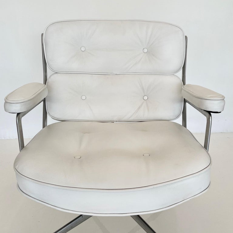 Classic Eames time life swivel chair in white leather. Unusual color. Chair swivels and reclines. Good vintage condition to metal and leather. Height adjustable with tilt back mechanism. Offered with original casters. The perfect vintage office