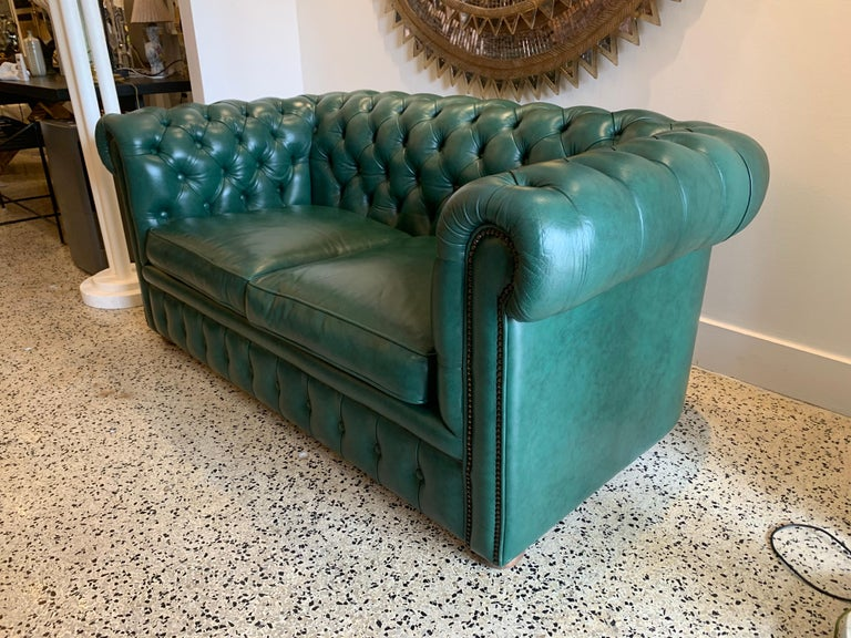 This original beautifully preserved soft hunter green leather small two-seat sofa is very masculine and small enough for an office. Original upholstery and walnut feet. Coil sprung feather filled cushions - Vintage green leather Chesterfield sofa