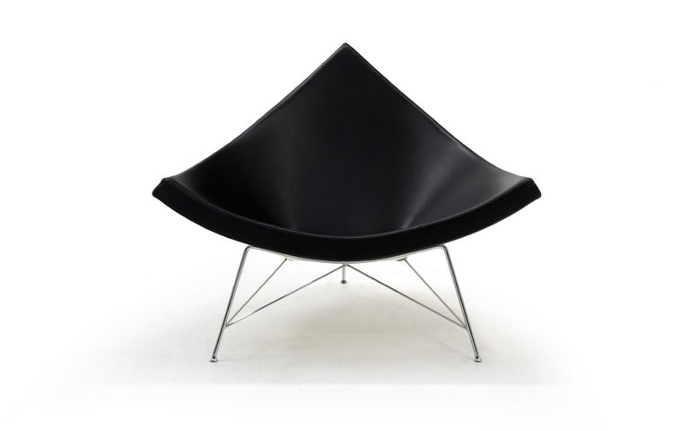 Coconut lounge chair designed by George Nelson for Herman Miller, manufactured by Vitra. Black leather, white shell and chrome legs. Very good original condition.