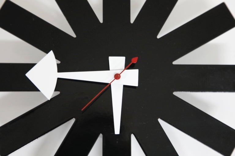 This Asterisk Clock by George Nelson Associates for Howard Miller is a rare find and one of the more in-demand of his designs. The black steel face, mounted on a metal back, is free of noticeable blemishes and the hour, minute and second hand are