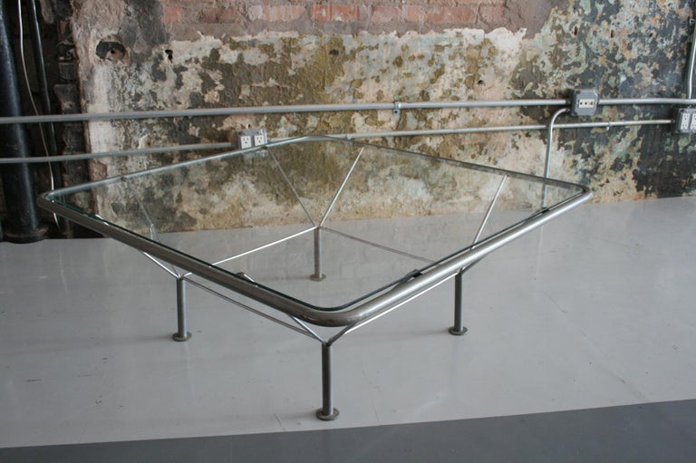 """Coffee table  Designed by Niels Bendtsen  Denmark, circa 1980s  Glass and refinished metal  Measure: 15"""" H x 39.5"""" W x 39.5"""" D."""