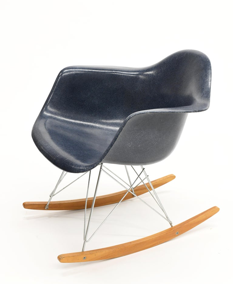 Original vintage rocking chair by Charles & Ray Eames for Herman Miller. Base is original and not a replica. Shock mounts are in good shape. The chair was acquired from Herman Miller in 1962.